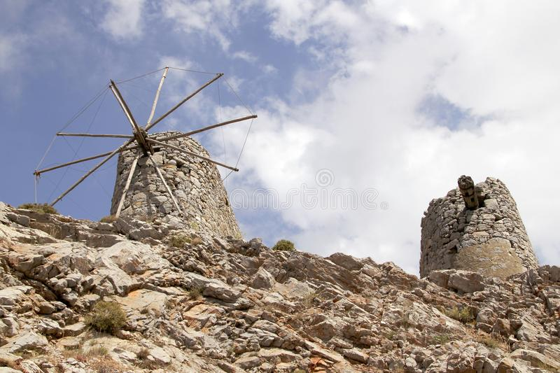 Ruins of ancient Venetian windmills built in 15th century, Lassithi Plateau, Crete, Greece. Most typical characteristic of the Plateau. In the past, they royalty free stock image