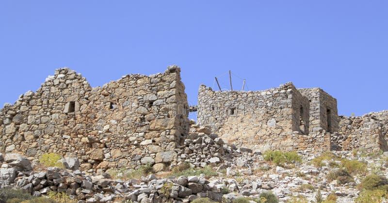 Ruins of ancient Venetian windmills built in 15th century, Lassithi Plateau, Crete, Greece stock photos