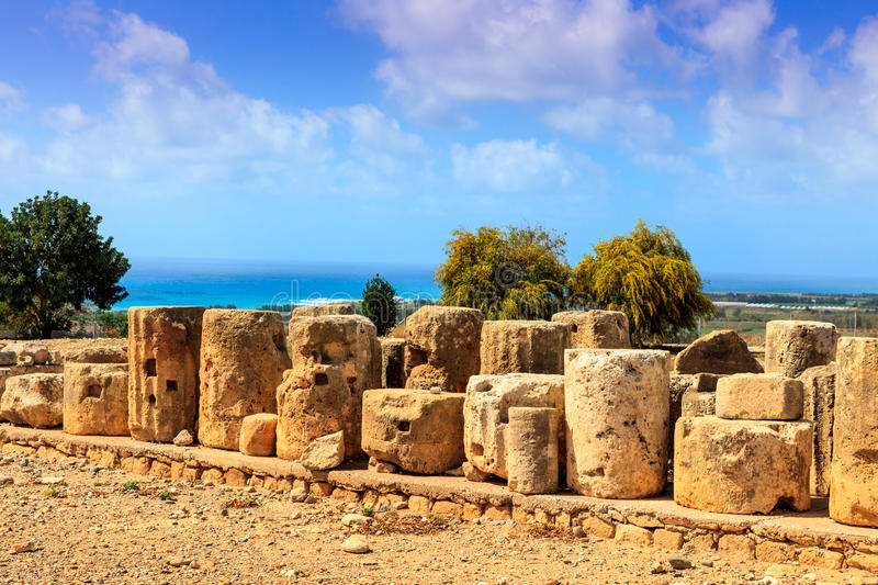 Ruins of the Aphrodte sanctuary in Cyprus. The ancient stones and columns are the preserved parts of the Aphrodite sanctuary in Kouklia, Cyprus stock photography