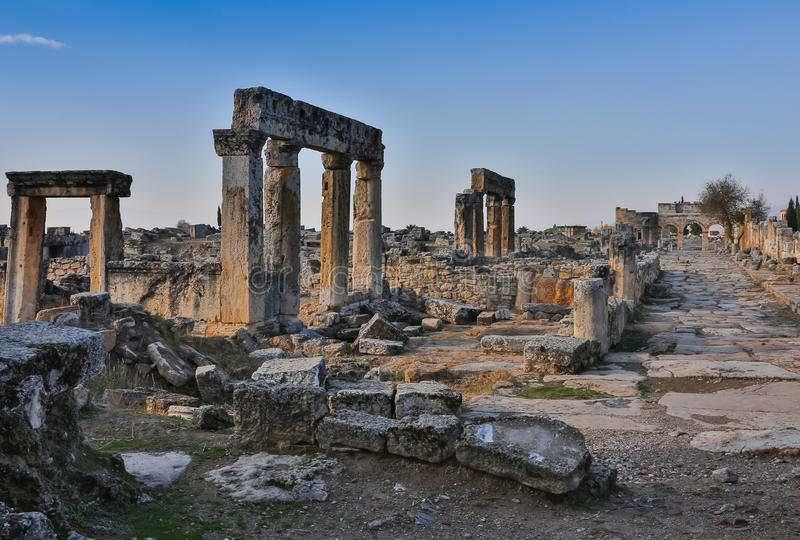 Ruins of Appollo temple with fortress at back in ancient Corinth, Peloponnese, Greece royalty free stock photos