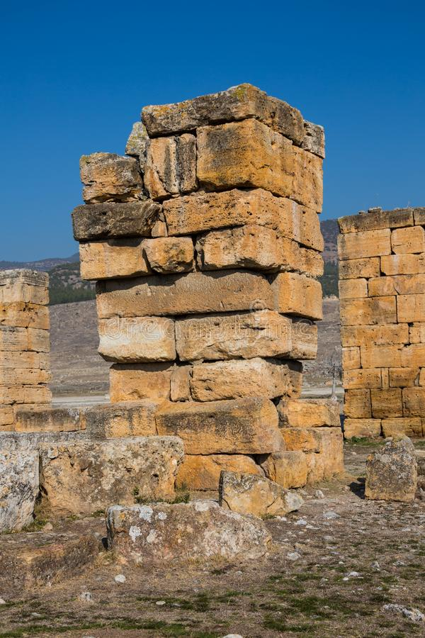 Ruins of Appollo temple with fortress at back in ancient Corinth, Peloponnese, Greece royalty free stock photography