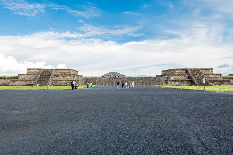 Ruins of the architecturally significant Mesoamerican pyramids and green grassland located at at Teotihuacan, an ancient. Mesoamerican city located in a sub stock photo