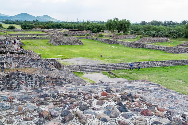 Ruins of the architecturally significant Mesoamerican pyramids and green grassland located at at Teotihuacan, an ancient. Ruins of walls and foundation of the stock images