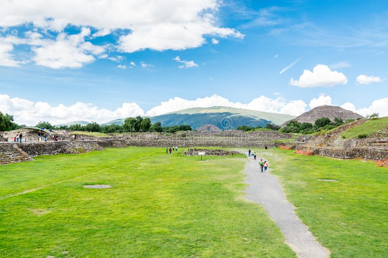 Ruins of the architecturally significant Mesoamerican pyramids and green grassland located at at Teotihuacan, an ancient. Ruins of walls and foundation of the stock photography