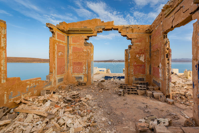 The ruins on the banks of Water Reservoir El Mansour Eddahbi. Ruins of a house on the shore Water reservoirs El Mansour Eddahbi in Morocco royalty free stock images