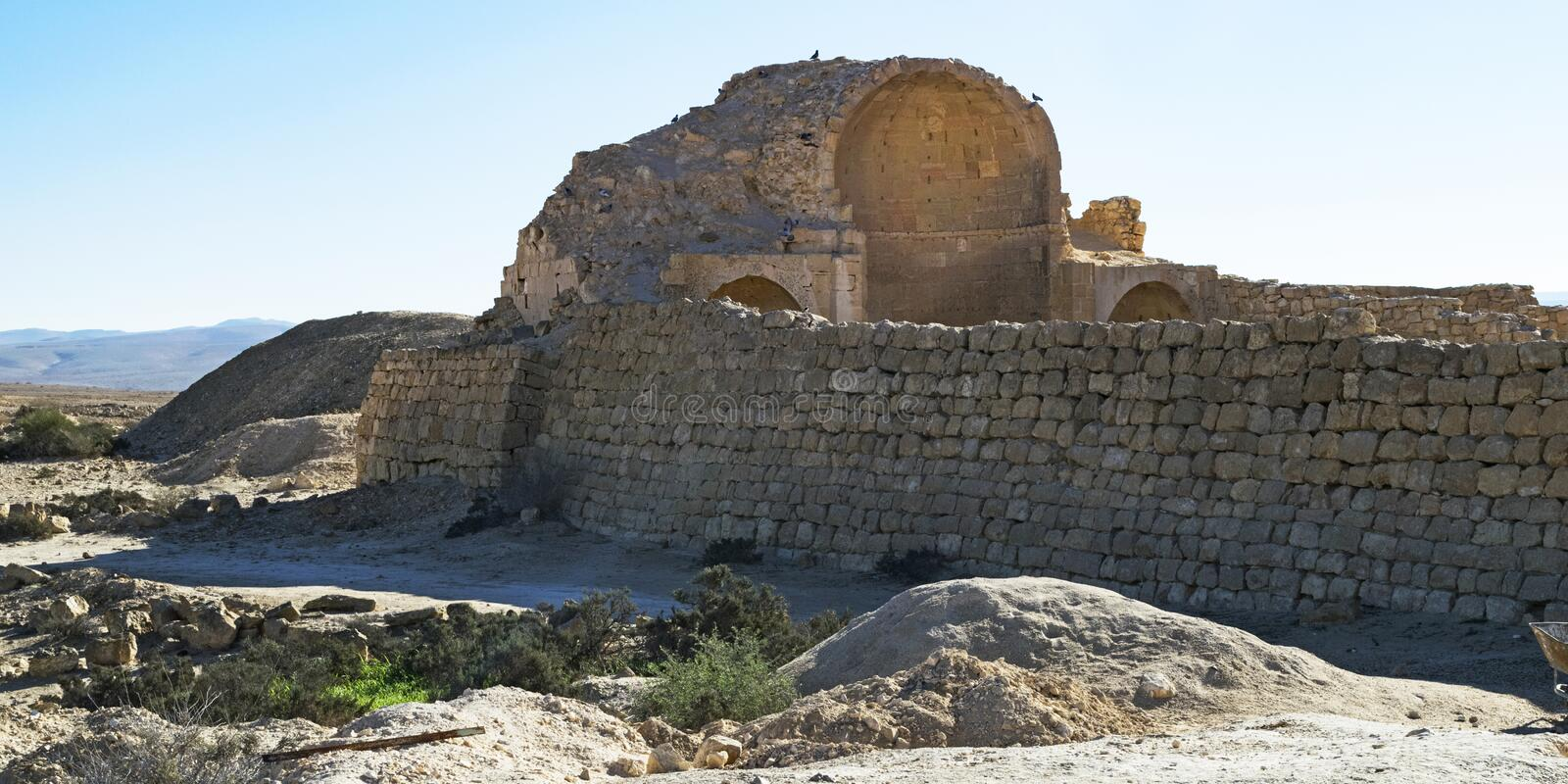 Ruins of Byzantine Church at Shivta in Israel. Ruins of the northern church of shivta national park in the negev desert in israel with birds perched on top of stock images