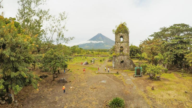 The ruins of Cagsawa church, showing Mount Mayon erupting in the background. Cagsawa Albay Philippines. The ruins of Cagsawa church, showing Mount Mayon royalty free stock photo