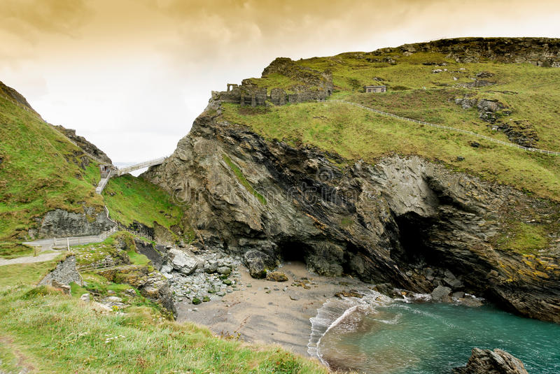 Ruins of the castle of Camelot. And Merlin's Cave at Tintagel in Cornwall stock photos