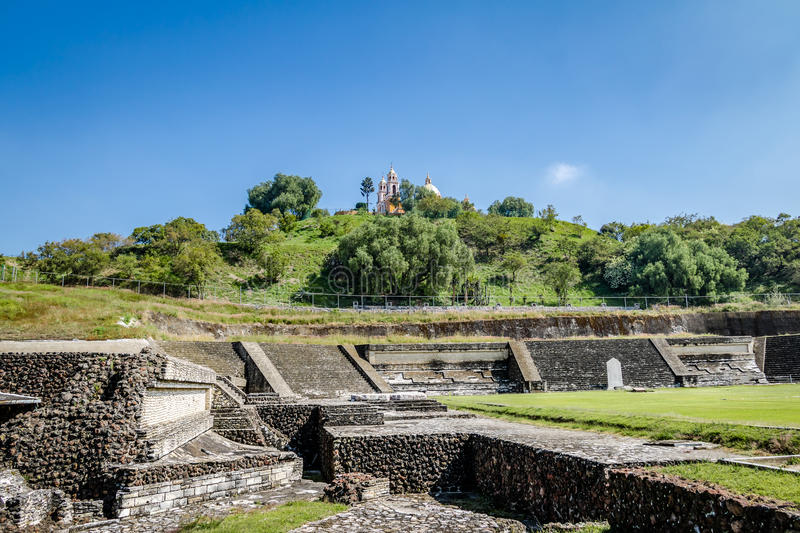 Ruins of Cholula pyramid with Church of Our Lady of Remedies at. The top of it in Cholula, Puebla, Mexico stock images