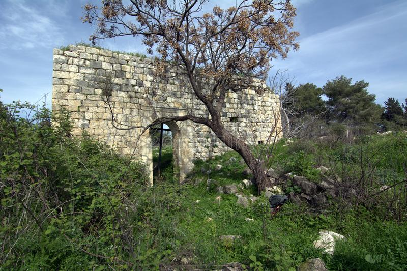 Ruins of the Christian church among flowering trees in the Golan Heights in spring in Israel royalty free stock photos
