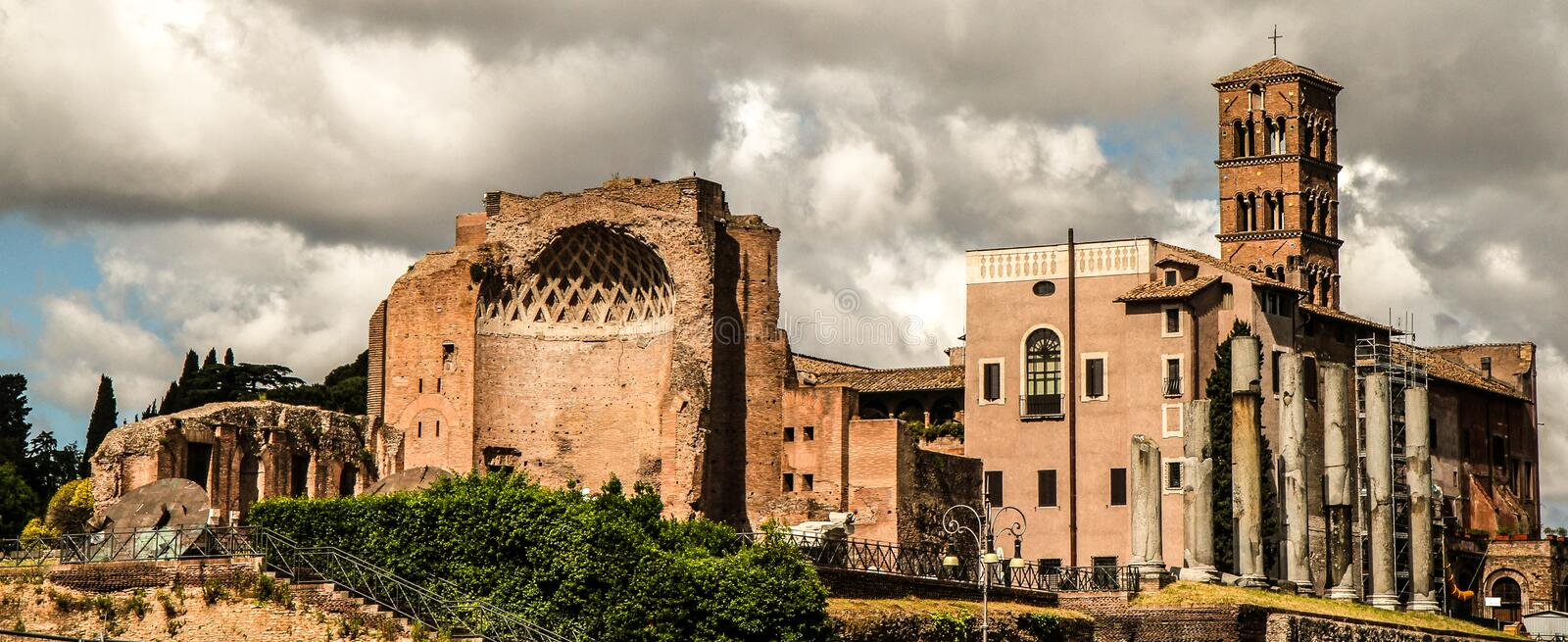 Ruins and church. Different architecture styles live in harmony in Roma stock photos
