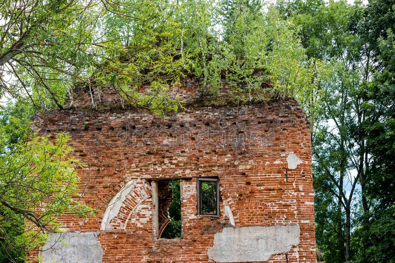 Ruins of the Church of St. Nicholas the Wonderworker in the village of Avchurino. Ferzikovsky District, Kaluzhskiy region, Russia - July 2019 stock images