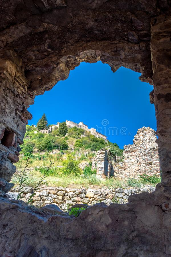 Ruins and churches of the medieval Byzantine ghost town-castle of Mystras, Peloponnese. Ruins and churches of the medieval Byzantine ghost town-castle of stock photo