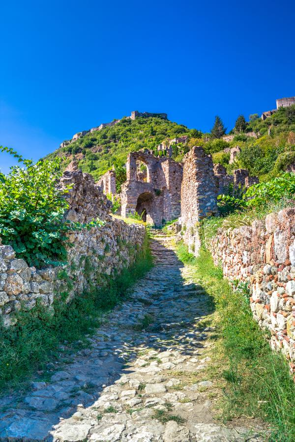 Ruins and churches of the medieval Byzantine ghost town-castle of Mystras, Peloponnese. Ruins and churches of the medieval Byzantine ghost town-castle of stock image