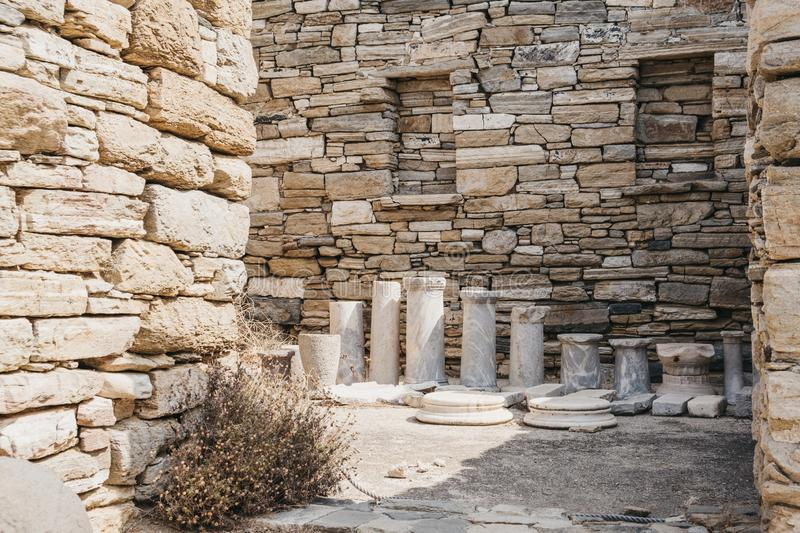Ruins and columns in the Theatre Quarter on the island of Delos, Greece. An archaeological site near Mykonos in the Aegean Sea Cyclades archipelago royalty free stock image