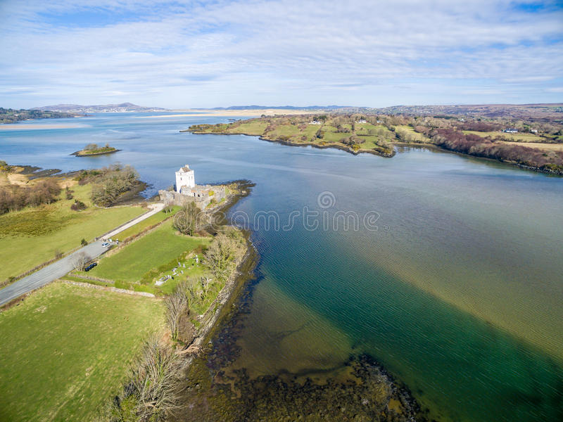 Ruins of Doe Castle in the sun, aerial stock photos