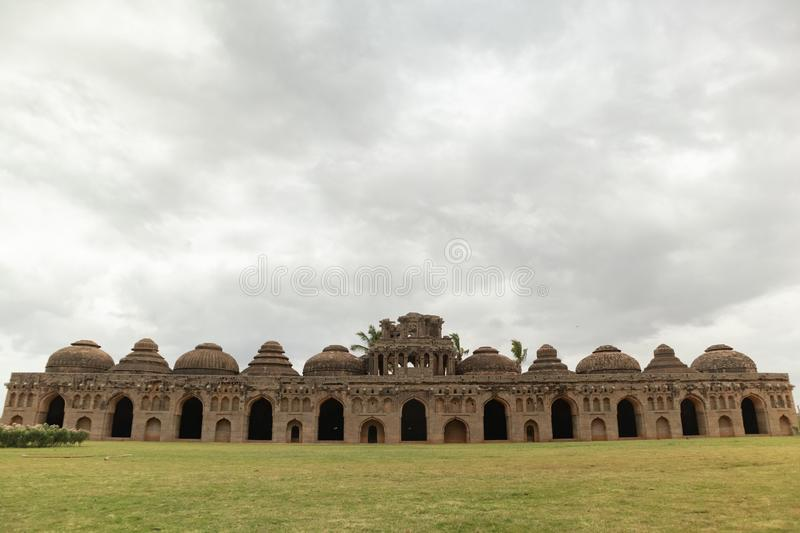 Ruins of the Elephant Stable inside Zanana enclosure at Hampi from 14th century Vijayanagara kingdom at Hampi, Karnataka, India royalty free stock image
