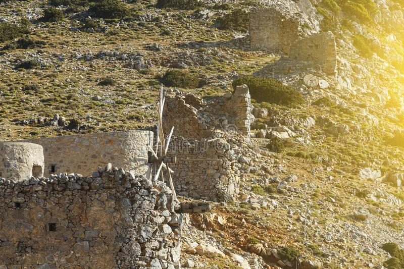 Ruins of encient windmills built in 15th century. Lassithi Plateau, Crete, Greece. Most typical characteristic of royalty free stock image