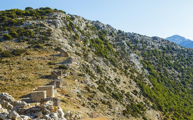 Ruins of encient windmills built in 15th century. Lassithi Plateau, Crete, Greece. Most typical characteristic of the. Plateau.In the past they numbered stock photo