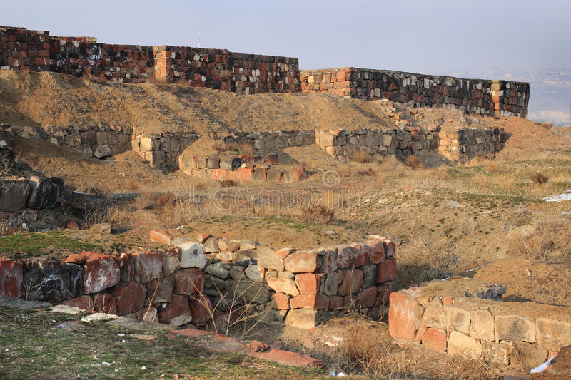 The ruins of Erebuni Fortress (Armenia) in winter. Erebuni Fortress (also known as Arin Berd -Fortress of Blood) is an Urartian fortified city, located in royalty free stock photography