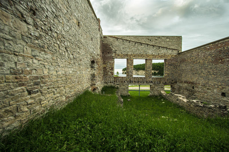 Ruins Of Fayette Ghost Town. Interior of an abandoned building with open windows facing the limestone cliffs on Lake Michigan. Fayette State Historical Park stock photos