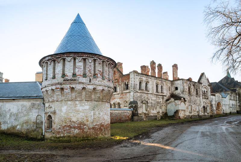 Ruins of Feodorovsky town, Tsarskoye Selo. North corner tower and the white stone chambers of the old crumbling Feodorovsky town of Tsarskoye Selo, Saint royalty free stock images