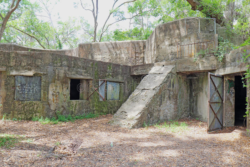 Ruins of Fort Fremont near Beaufort, South Carolina. Concrete ruins of the gun battery at Fort Fremont, constructed during the Spanish-American war beginning in stock photography