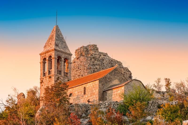 Ruins of fortress Čačvina and church All the Saints. Near town of Trilj in Dalmatian Zagora. Tower and church are placed on the hill overlooking the town stock images