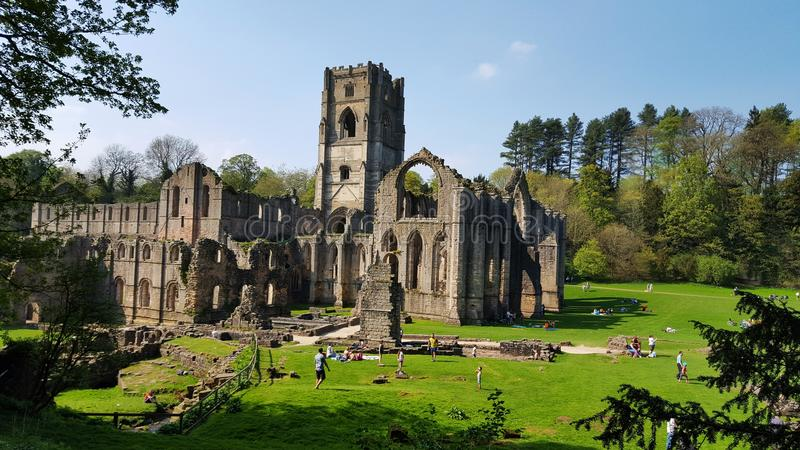 Ruins of Fountains Abbey, Studley Royal Water Garden. England. People can visit every corner of beautiful Fountains Abbey and Studley Royal Water Garden. UNESCO stock photo