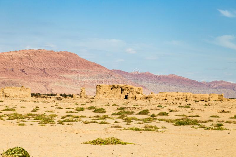 Ruins of Gaochang, Turpan, China. Dating more than 2000 years, Gaochang and Jiaohe are the oldest and largest ruins in Xinjiang. The Flaming mountains are stock photography