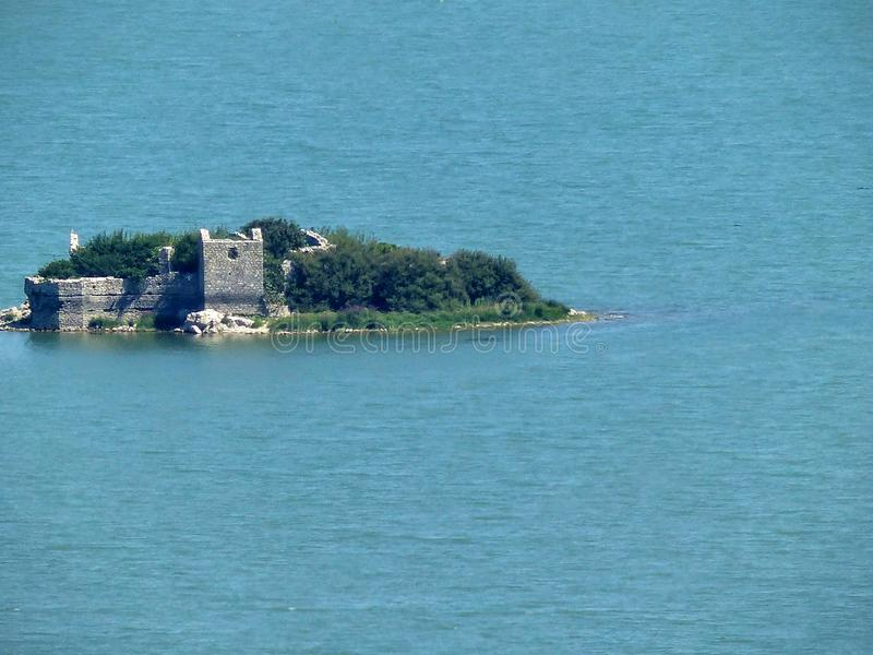 Ruins of Gmozur, old prison island on Skadar lake, Montenegro. stock images