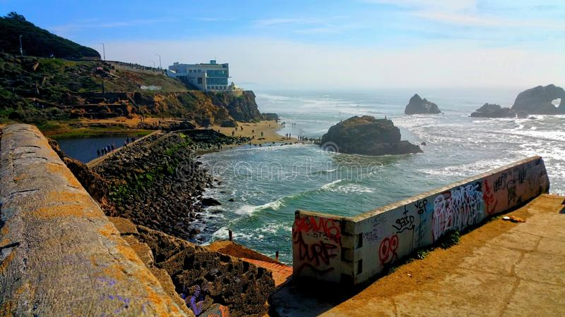 Ruins & Graffiti. Old sutro bath ruins at ocean beach in San Francisco. Great exploration opportunity for rewilding. Graffiti mars the old walls. Such a sad stock photo