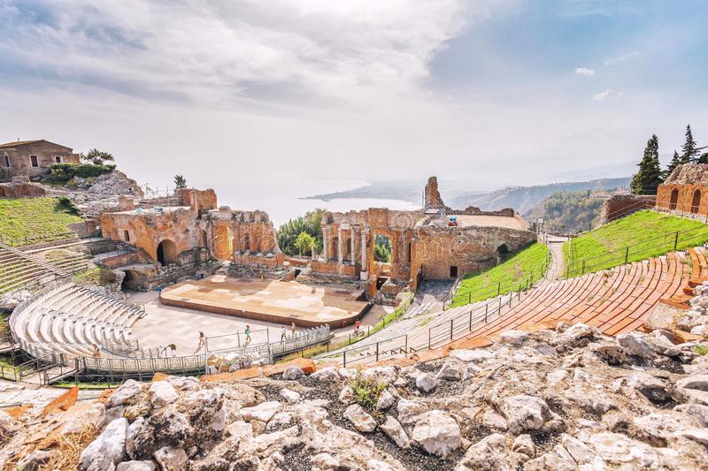 Ruins of the Greek Theater of Taormina and the picturesque mountain chain from the vulcano Etna to Castelmola royalty free stock photo