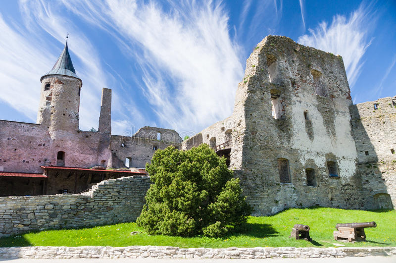 Ruins of Haapsalu Episcopal Castle and cannons. In front, Estonia royalty free stock photography