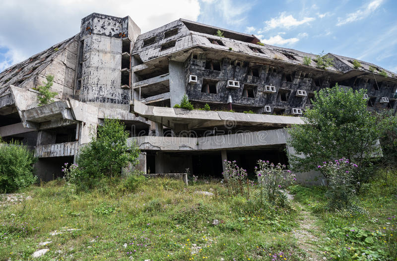 Ruins of hotel. Hotel building damaged during Siege of Sarajevo near Igman Olympic Jumps in Bosnia and Herzegovina royalty free stock photo
