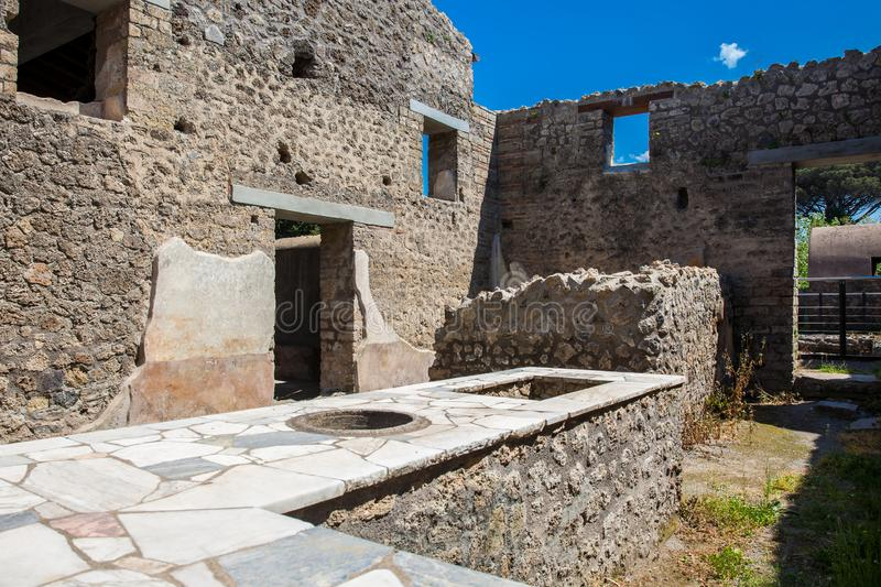 Ruins of the houses in the ancient city of Pompeii. The ruins of the houses in the ancient city of Pompeii stock photography
