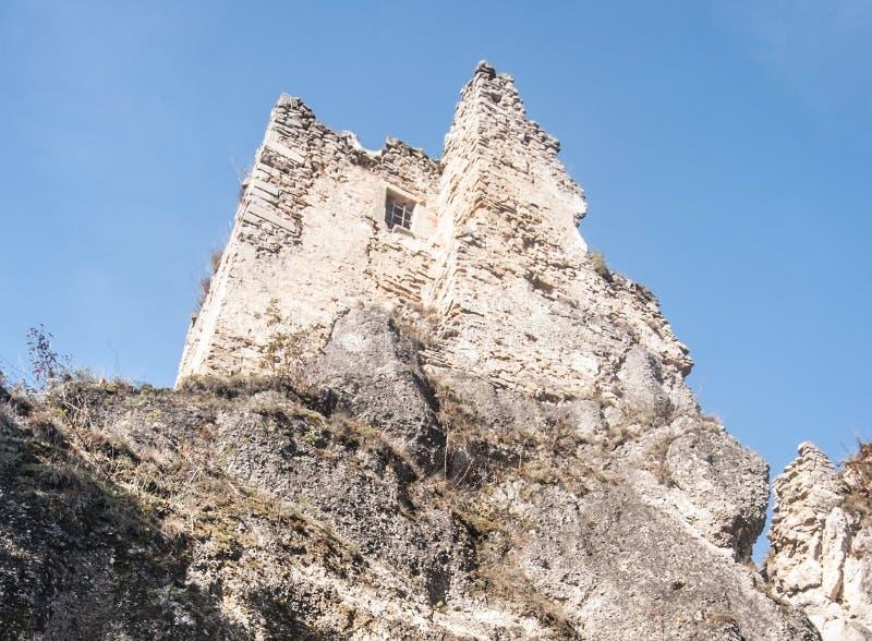 Ruins of Hricovsky hrad castle in Sulovske vrchy mountains in Slovakia above Hricovske Podhradie village. With clear sky stock photos