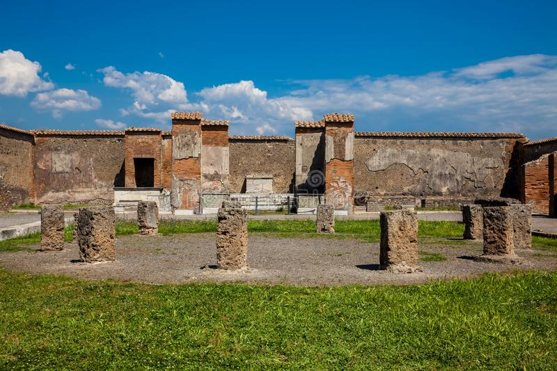 Ruins of the Macellum in the ancient city of Pompeii in a beautiful early spring day. The ruins of the Macellum in the ancient city of Pompeii in a beautiful royalty free stock images