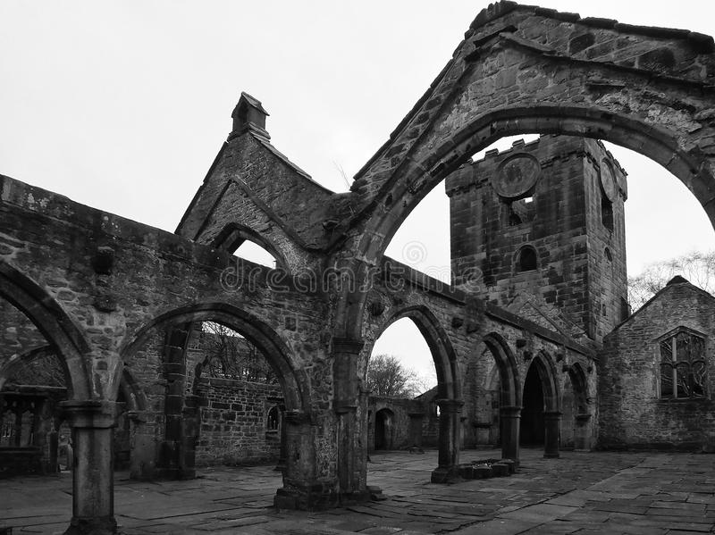 ruins of a medieval church in heptonstall with arches stone floor and bell tower royalty free stock images