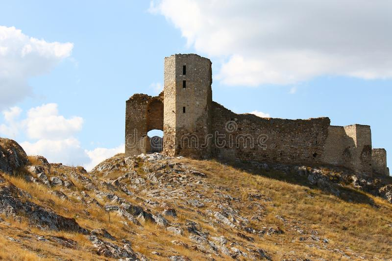 Ruins of Enisala old fortress on rocky hill. The ruins of the medieval fortress of Enisala can be found in Romania near the Danube Delta stock image