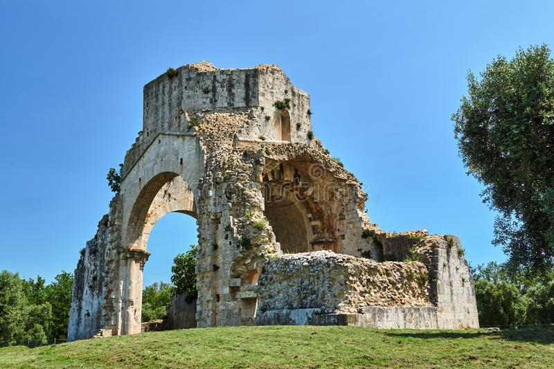 Ruins of a medieval stone church next to the town of Magliano. In Toscana, Italy stock image