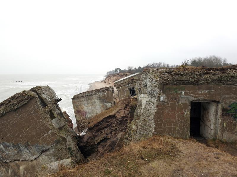 Ruins of the northern forts on Baltic sea coast , Latvia. Ruins of the northern forts on baltic sea coast , part of old Soviet base in Karosta in rainy day stock photography
