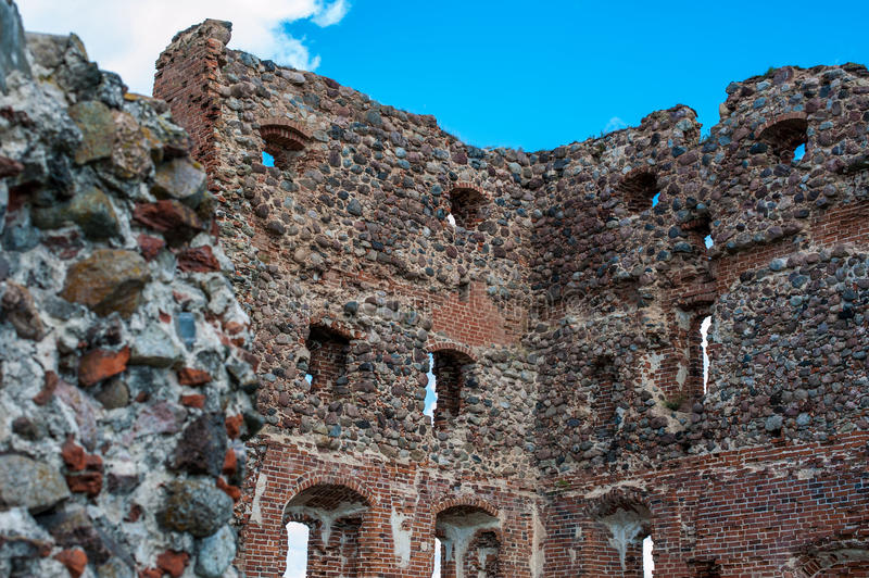 Ruins of an old castle Ludza with lake stock images
