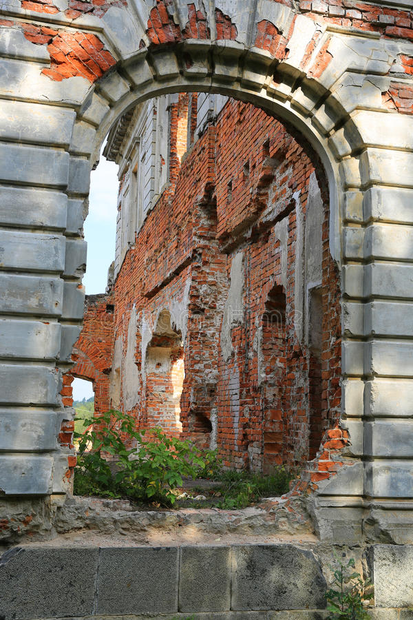 Ruins of old castle. View thought arch royalty free stock photos
