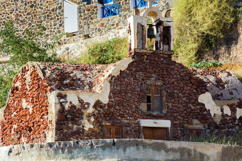 Ruins of old church on rock of Oia town at Santorini island, Greece stock photos