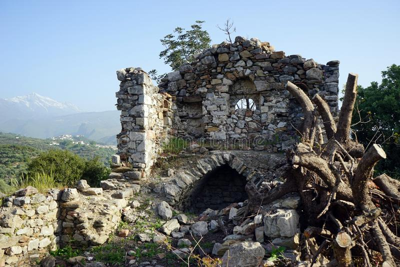 Ruins of church. Ruins of old greek orthodox church and mountain in Greece royalty free stock image