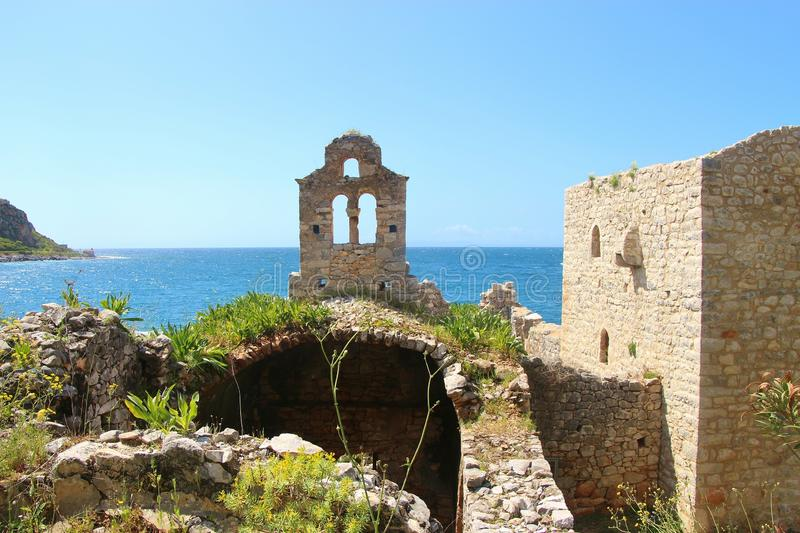 Ruins of an old stone church in the coastal town Limeni. Peloponnese, Greece royalty free stock photos