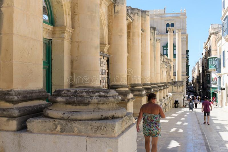 Valletta, Malta, August 2019. Colonnade of the destroyed drama theater and street view. royalty free stock photos