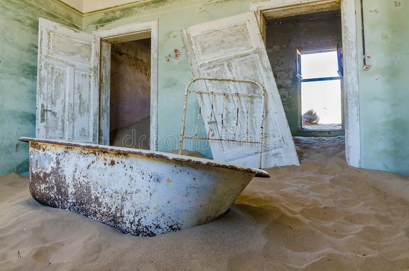 Ruins of once prosperous German mining town Kolmanskop in the Namib desert near Luderitz, Namibia, Southern Africa.  royalty free stock images