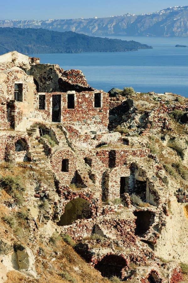 Ruins over caldera in Oia village, Greece royalty free stock photo